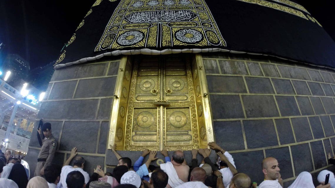Muslim pilgrims gather around the door of the Kaaba at the Grand Mosque on the first day of Eid al-Adha in the holy city of Mecca October 4, 2014. (Reuters)