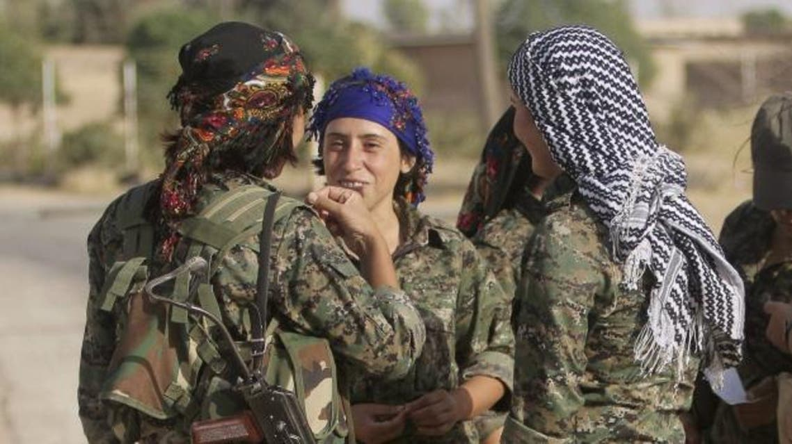 Women fighters of the Kurdistan Workers' Party on the front line in the Makhmur area near Mosul in Iraq on August 21 during the conflict with the ISIS. (Reuters)