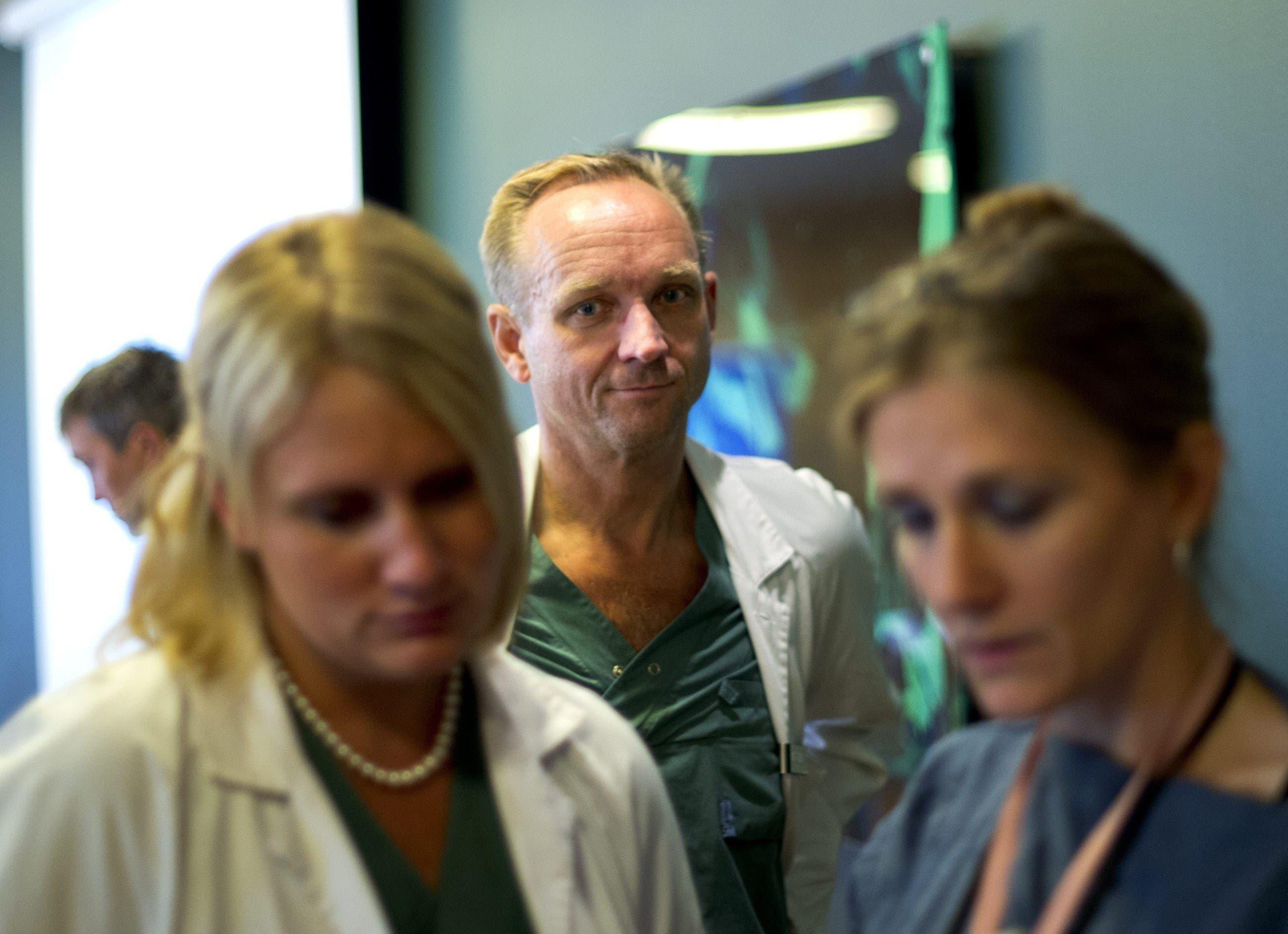 A picture taken on September 18, 2012 shows Doctor Mats Braennstroem (C) during a press conference about the first uterus transplant at the Sahlgreska hospital in Gothenburg, Sweden. (AFP)