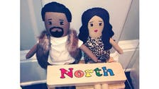 Kardashian's daughter plays with replica dolls of mom and dad