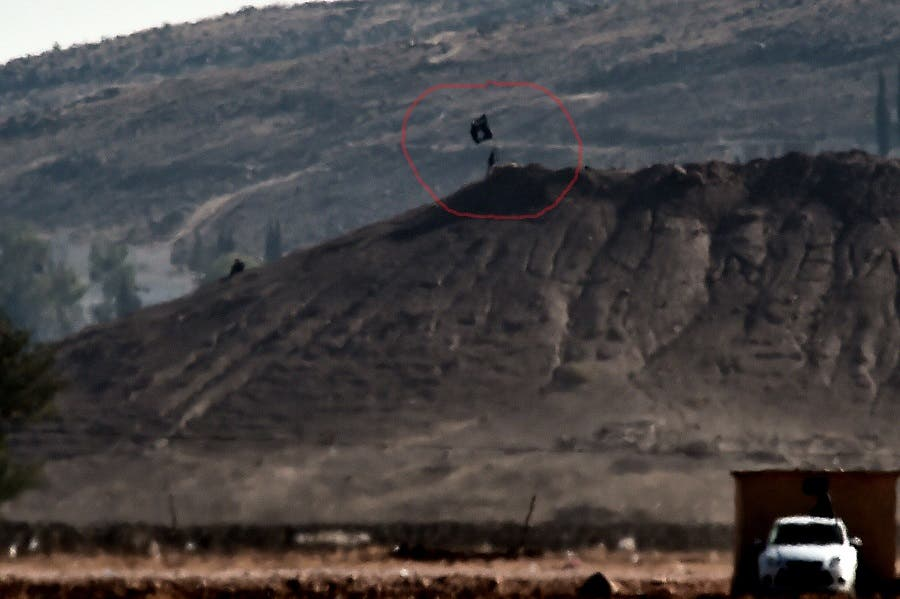 An ISIS flag is placed on a hill in the Syrian town of Kobane as seen from the Turkish-Syrian border in the southeastern town of Suruc, Sanliurfa province, on Oct. 6, 2014. (AFP)