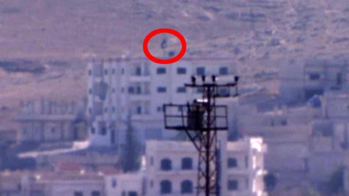 رفع علم داعش في كوباني