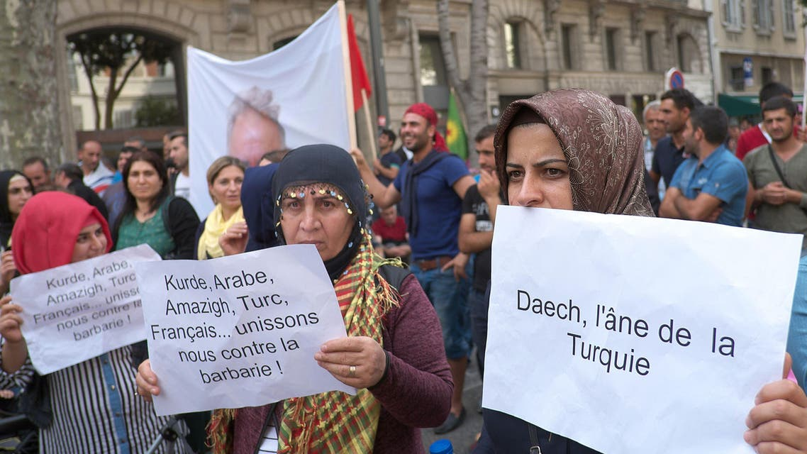 """Pro-Kurdish protesters demonstrate against the threat of a """"Syrian Kurdish population's genocide"""" by Islamic State (IS) militants and to support the population of the Syrian Kurdish town of Ain al-Arab, known as Kobane by the Kurds"""