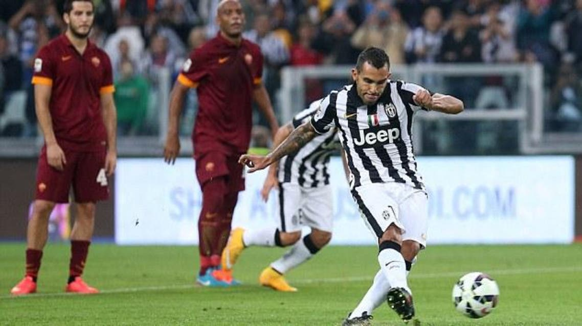 Carlos Tevez scores his first of two penalties to put Juventus into the lead in Sunday's 3-2 win against Roma  Read more: http://www.dailymail.co.uk/sport/football/article-2783005/Juventus-vs-Napoli-Italian-Super-Cup-clash-played-Doha.html#ixzz3FQtwWTq5 Follow us: @MailOnline on Twitter | DailyMail on Facebook. (AFP)