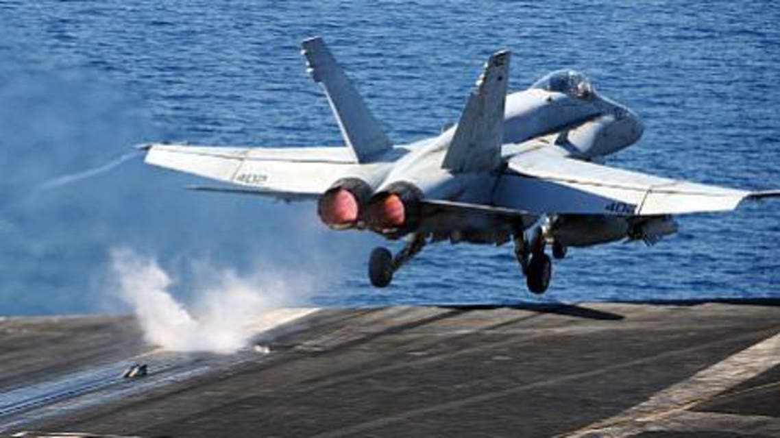 An F/A-18C Hornet assigned to the Golden Warriors of Strike Fighter Squadron (VFA) 87 takes off from the flight deck of the aircraft carrier USS George H.W. Bush (CVN 77) strike operations in Iraq and Syria (U.S. Navy photo)