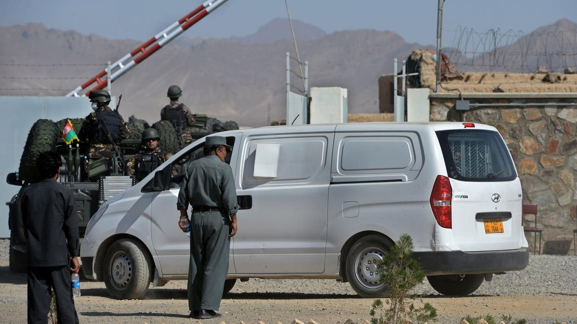 Afghan security forces escort a van allegedly transporting Afghan men to be executed, at Pul-e-Charkhi prison, on the outskirts of Kabul on October 8, 2014. (AFP)