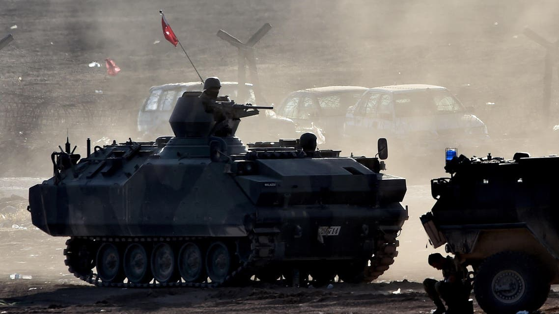 Turkish soldiers patrol along the Turkish border with Syria, in the southeastern town of Suruc, in Sanliurfa province, on October 8, 2014.