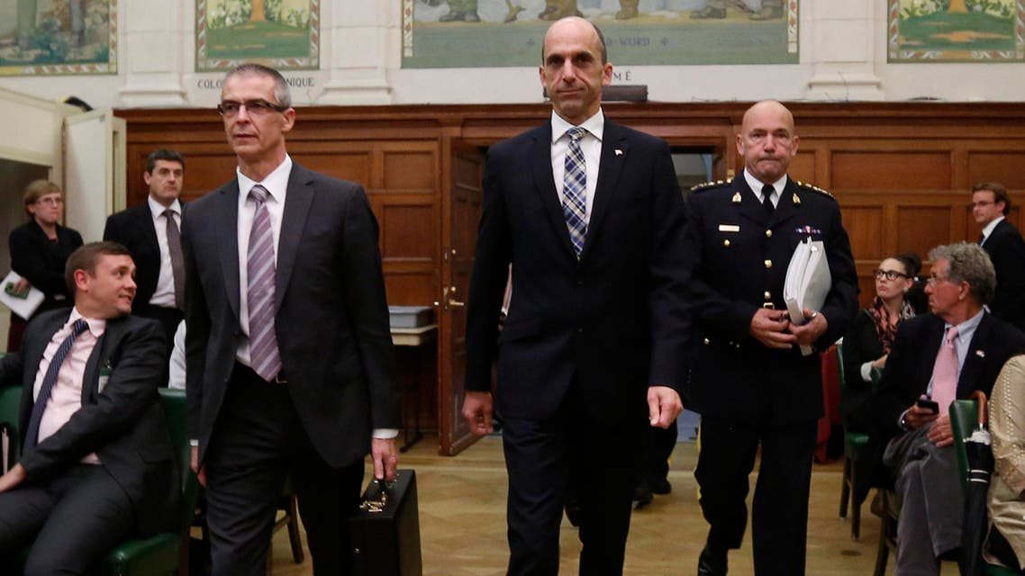 Canada's Public Safety Minister Steven Blaney (C) arrives with Canadian Security Intelligence Service (CSIS) director Michel Coulombe (L) to testify before the Commons public safety and national security committee on Parliament Hill in Ottawa October 8, 2014. (Reuters)