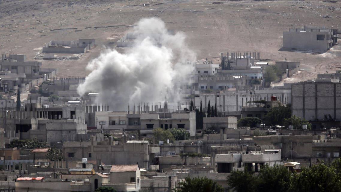Smoke rises from the Syrian town of Kobane, seen from near the Mursitpinar border crossing on the Turkish-Syrian border in the southeastern town of Suruc, Sanliurfa province, on Oct. 3, 2014. (AFP)