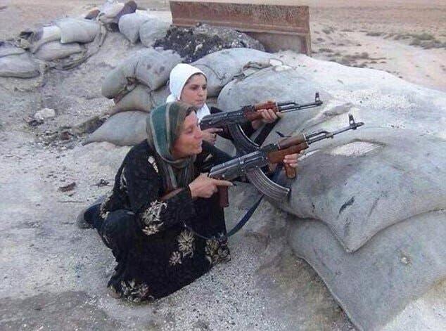 نساء وأطفال يقاتلون دفاعاً عن كوباني