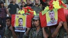 Kurds bury Kobane dead in makeshift graves over border