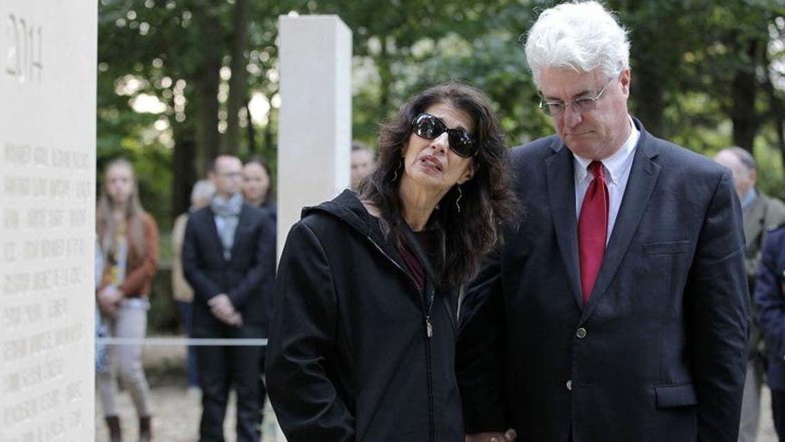 US journalist James Foley's parents stand in the war reporters' memorial after the unveiling of a stone in honor of the war reporters killed in 2014. (AFP)