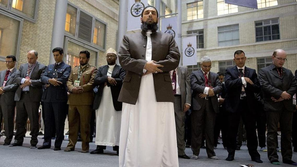 Imam Asim Hafiz, OBE the Islamic advisor to the Armed Forces leads the Prayers in the Ministry of Defense last July. (Credit:  UK Ministry of Defence)
