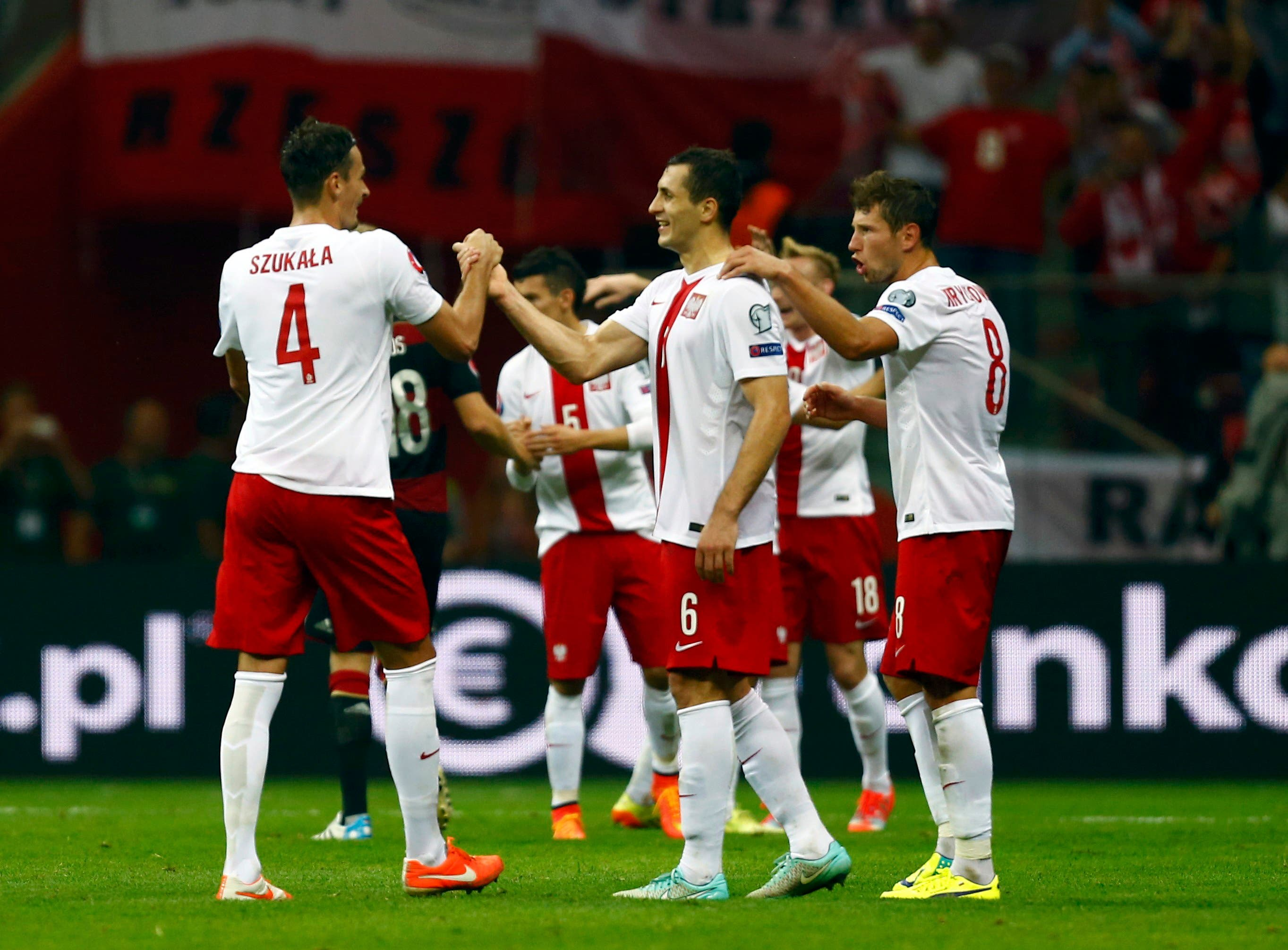 Poland's players celebrate after their Euro 2016 group D qualifying soccer match against Germany at the National stadium in Warsaw October 11, 2014.  (Reuters)
