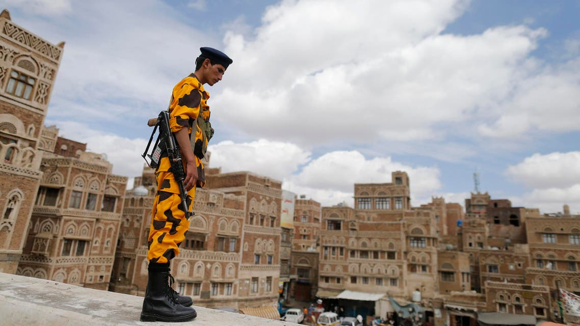 A Shi'ite Houthi rebel in police uniform stands guard on a wall in downtown Sanaa October 8, 2014. (Reuters)
