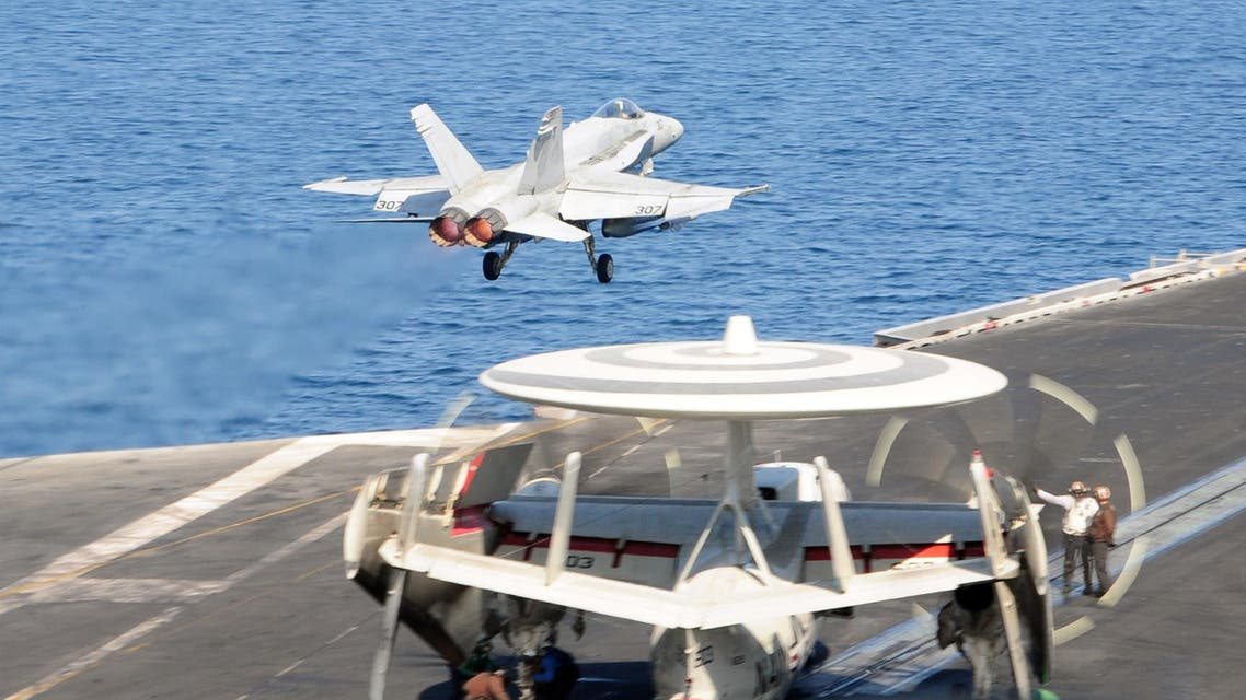 In this image released by the US Navy, an F A-18C Hornet, launches from the flight deck of the aircraft carrier USS George H.W. Bush in The Gulf on October 10, 2014.  (AFP)