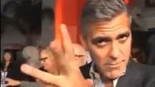 George Clooney busts a Middle Eastern dance move