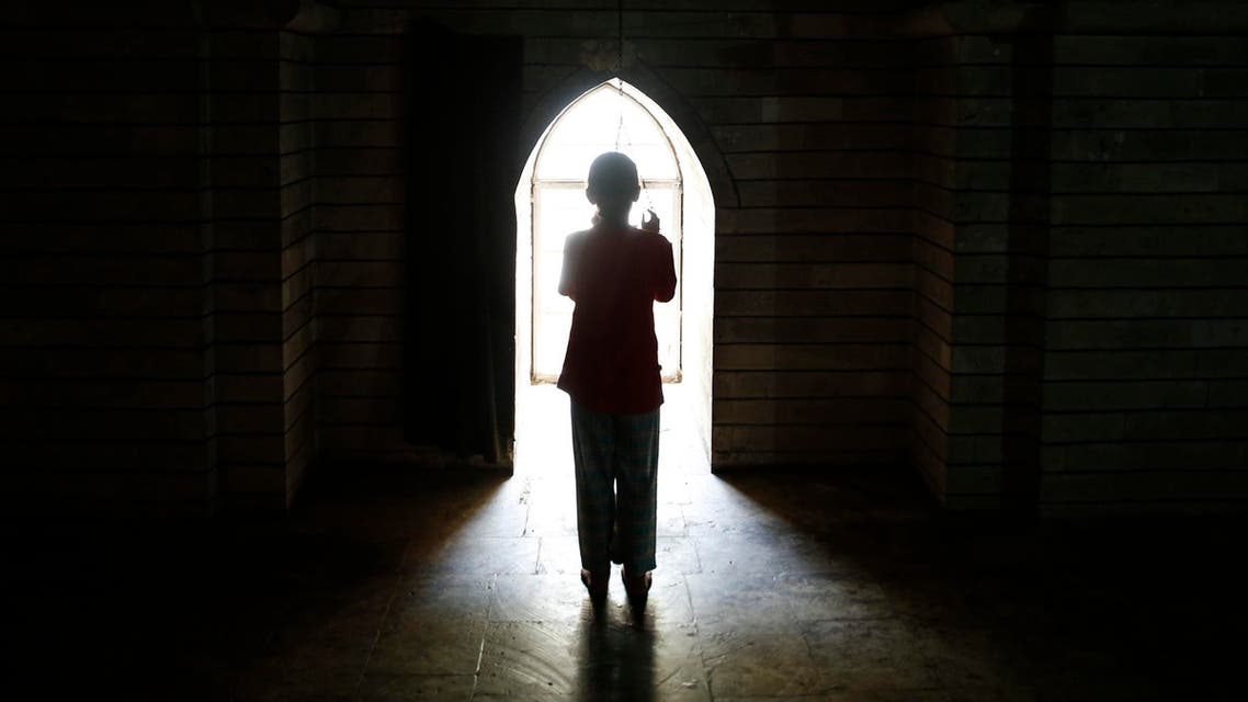 A displaced girl from the Yazidi sect worships at the holy temple Lalish in Shikhan September 20, 2014. (File photo: Reuters)