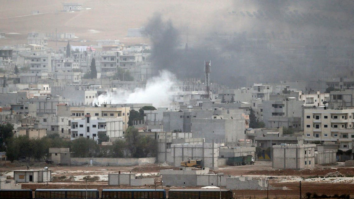 Smoke rises from the Syrian town of Kobani, as seen from the southeastern town of Suruc in Sanliurfa province October 11, 2014. (Reuters)