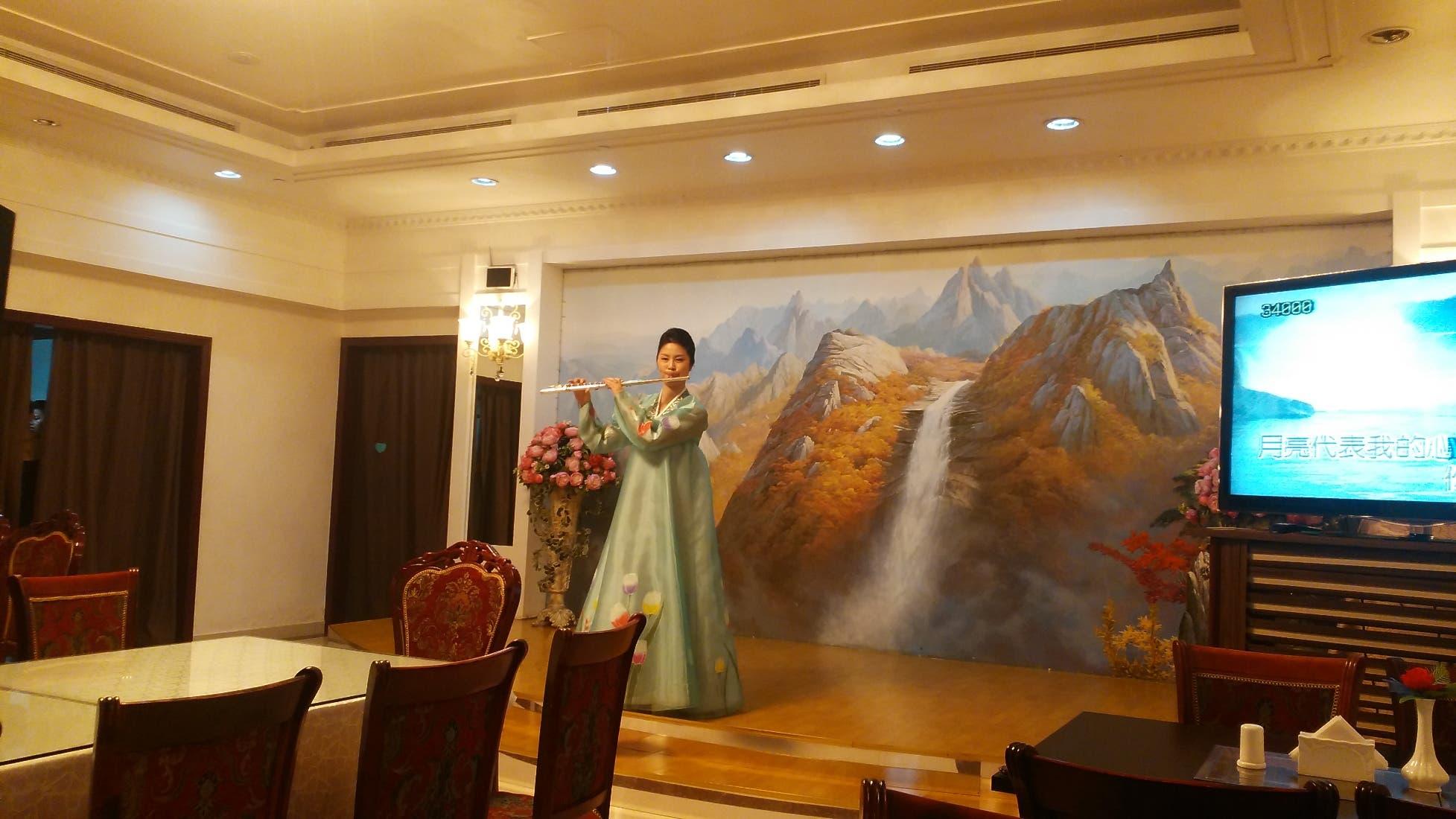 3- An Okryu-gwan flutist wearing a traditional North Korean dress. (Al Arabiya)