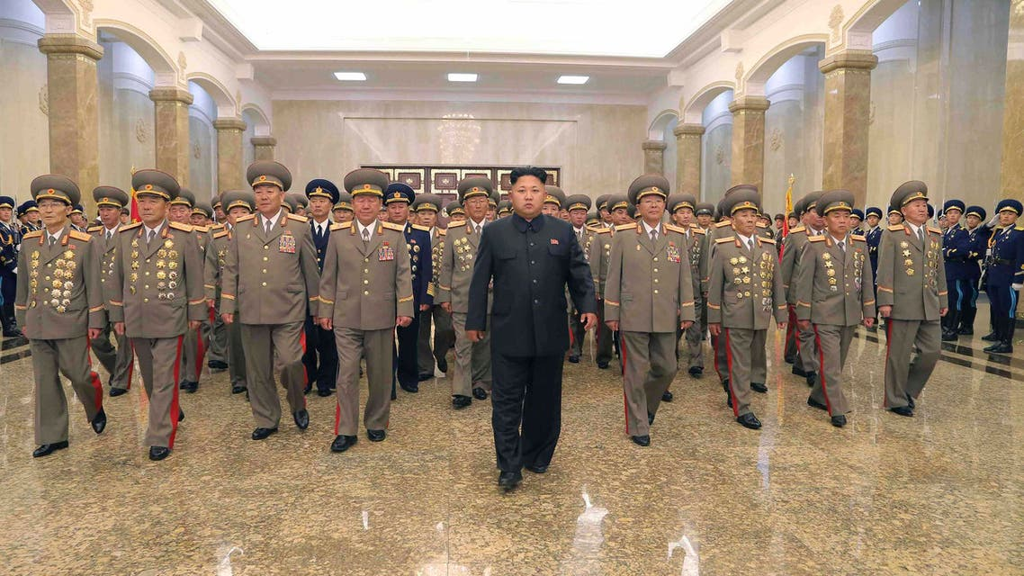 7- Kim Jong-un seen leading a group of military officals visiting the mausoleum where his father, Kim Jong-il and grandfather Kim Il-sung - both former leaders of North Korea - lie at rest. (Reuters)
