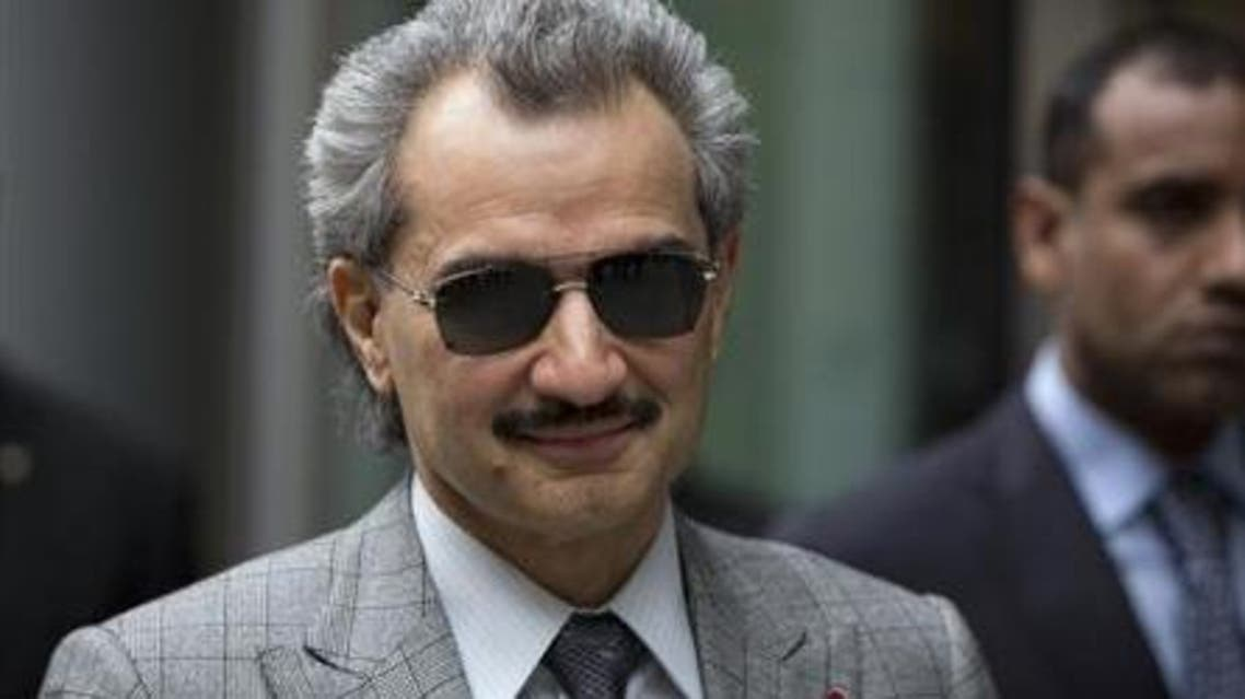 Prince Alwaleed bin Talal is seen leaving the High Court in London in this July 2, 2013 file photograph.