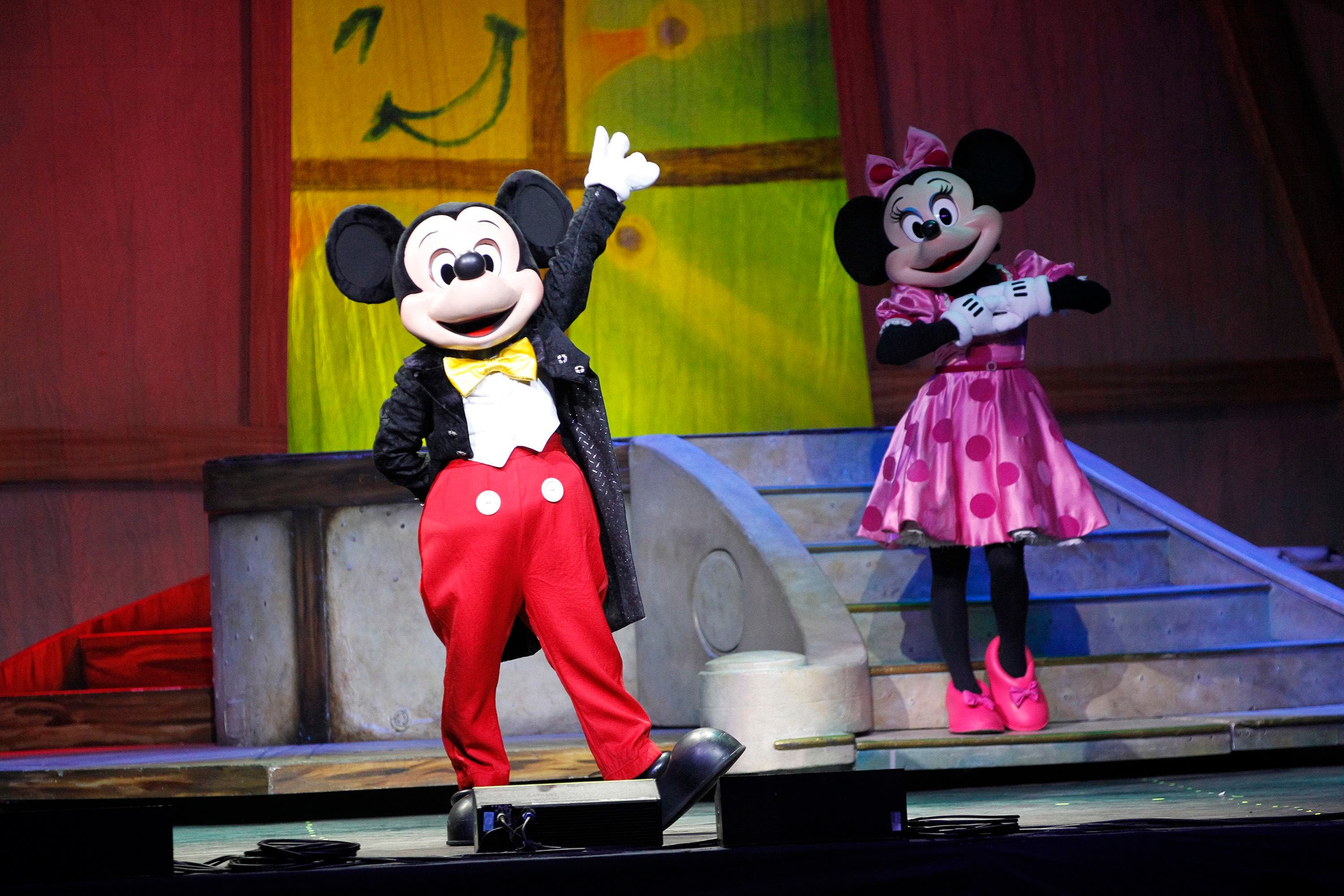 Actors dressed as Walt Disney characters Mickey Mouse and Minnie Mouse perform during a Disney Live! show. (Reuters)