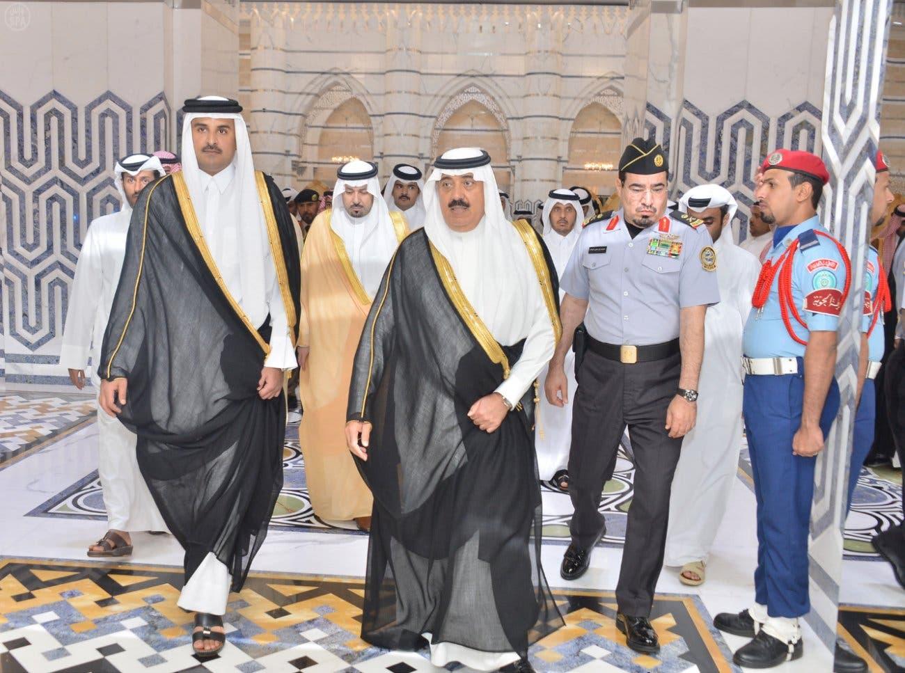 Qatari Emir Sheikh Tamim bin Hamad al-Thani, left, arrives at King Abdulaziz International Airport. (Saudi Press Agency)