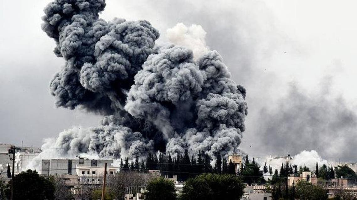 Smoke rises after a strike on Kobane as seen from the Turkish-Syrian border Photo: Saris Messinis/AFP/Getty Images