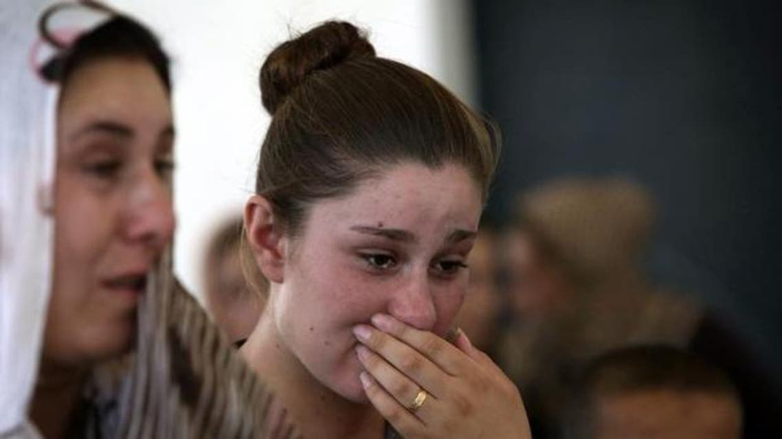 A Yazidi woman cries in the Kurdish city of Dohuk. (AFP)