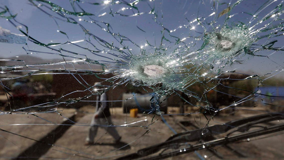 An Afghan man walks next to the cracked side window of a vehicle after was hit by a remote-controlled bomb in Kabul. (File photo: Reuters)
