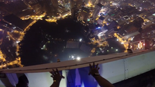 Base jumpers crash pool party in Malaysian capital