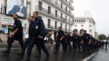 Algerian police march in rare protest in capital