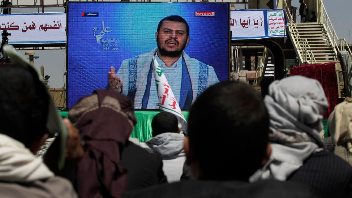 Followers of the Shi'ites Houthi group watch a televised speech by the group's leader Abdul Malik al-Houthi as they attend a ceremony marking th Eid al-Ghadir in Sanaa October 12, 2014.