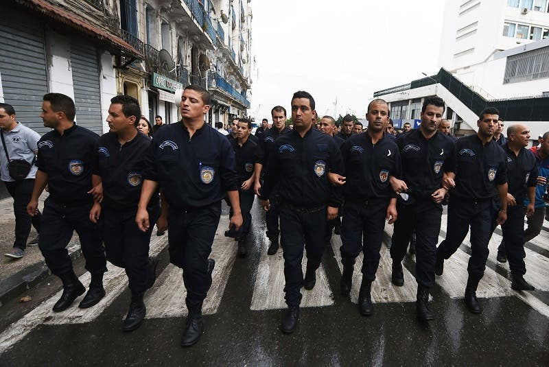 Algerian policemen take part in a public protest on Oct. 14, 2014 in Algiers (AFP)