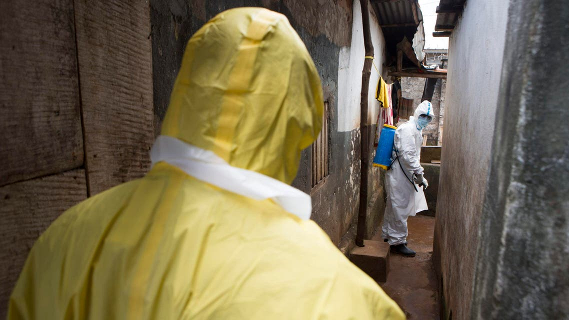 Health workers in protective equipment work near Rokupa Hospital, Freetown October 6, 2014. (Reuters)