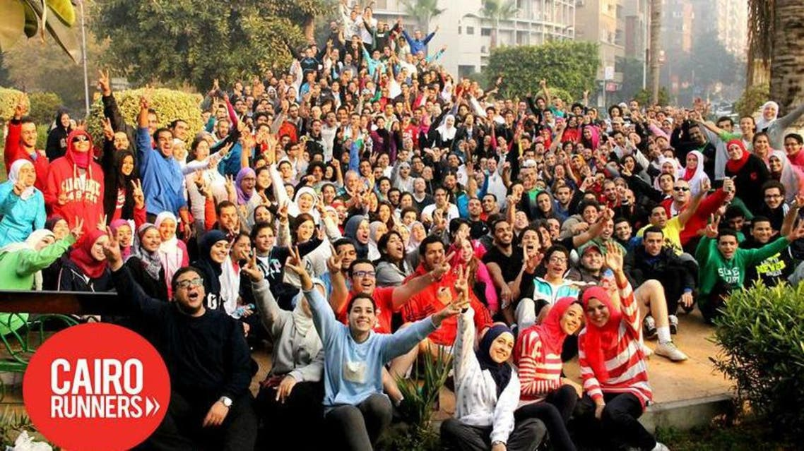 Cairo runners posing before a 7 kilometer run in Cairo's district of Dokki. a(Photo courtesy: cairorunners.com)