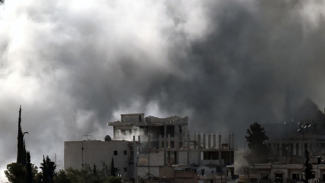 Smoke rises from the Syrian town of Ain al-Arab, known as Kobane by the Kurds. (AFP)