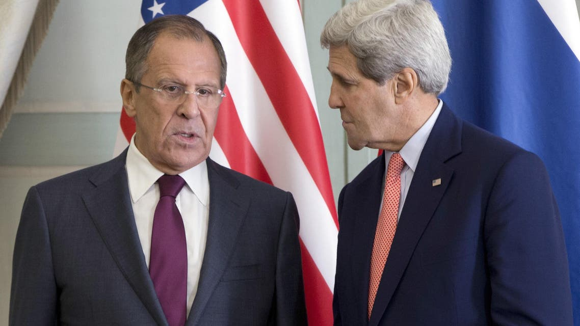 US Secretary of State John Kerry (R) speaks with Russian Foreign Minister Sergei Lavrov during a meeting at the Chief of Mission Residence in Paris on Oct. 14, 2014. (AFP)