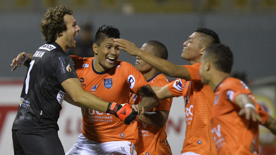 Peru's Cesar Vallejo players celebrate the goal by goalkeeper Salomon Lipman which allows them to pass to quarter finals. AFP