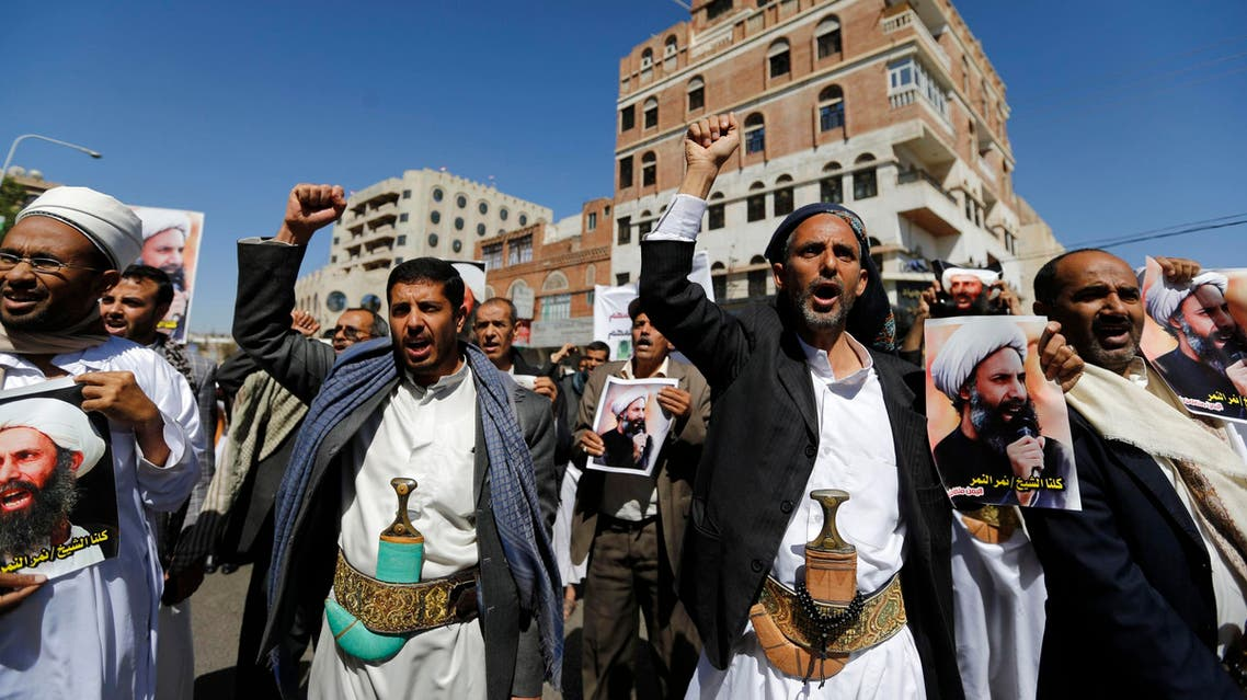 Shiite protesters shout slogans during a demonstration outside in Sanaa October 18, 2014. (Reuters)