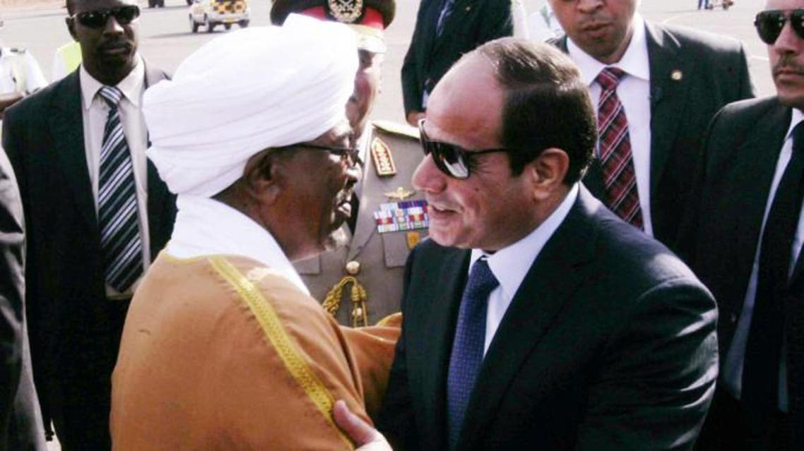 Sudanese President Omar al Bashir (L) welcomes Egyptian President Abdel Fattah al-Sisi upon his arrival at Khartoum airport for an official visit on June 27. (EBRAHIM HAMID/AFP/Getty Images)