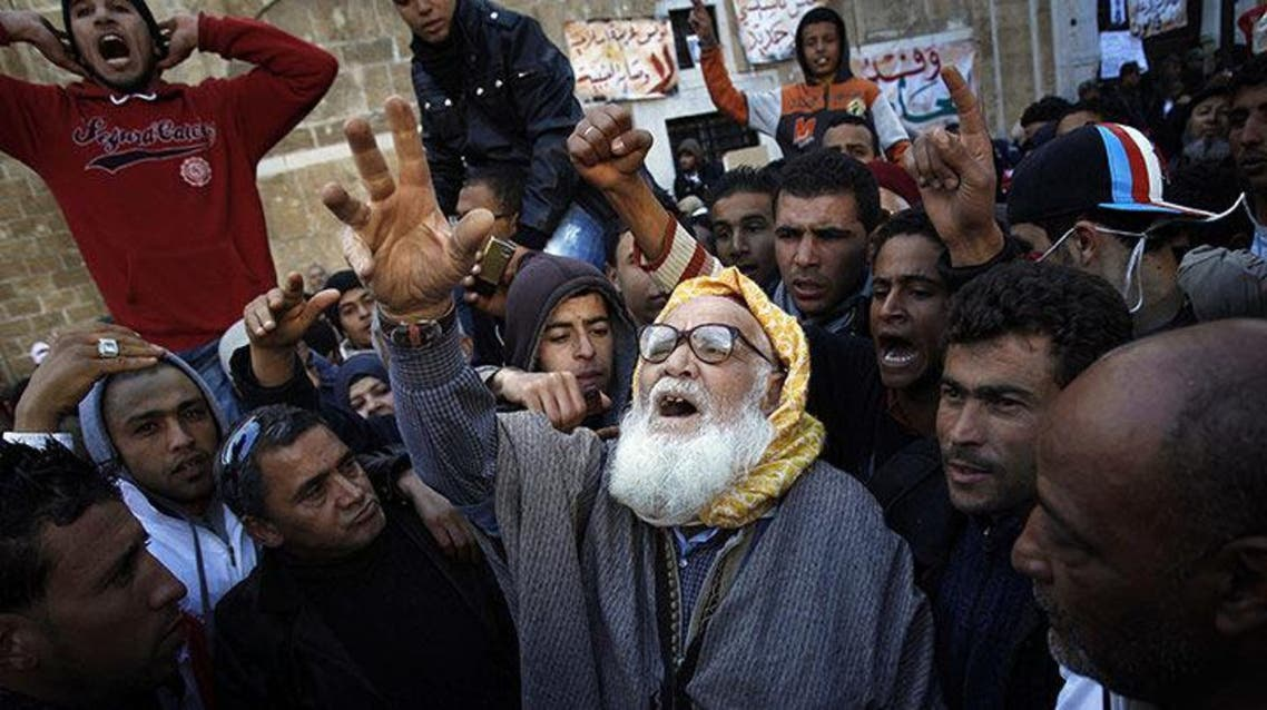 A man from rural Tunisia takes part in a demonstration in front of the prime minister's office in the capital, Tunis