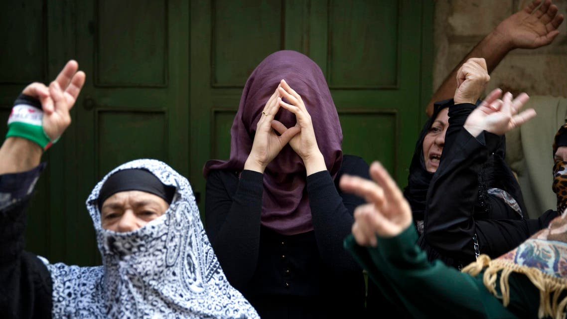 Palestinian women take part in a protest against Jewish visitors to the compound known to Muslims as Noble Sanctuary and to Jews as Temple Mount in Jerusalem's Old City October 14, 2014. (Reuters)