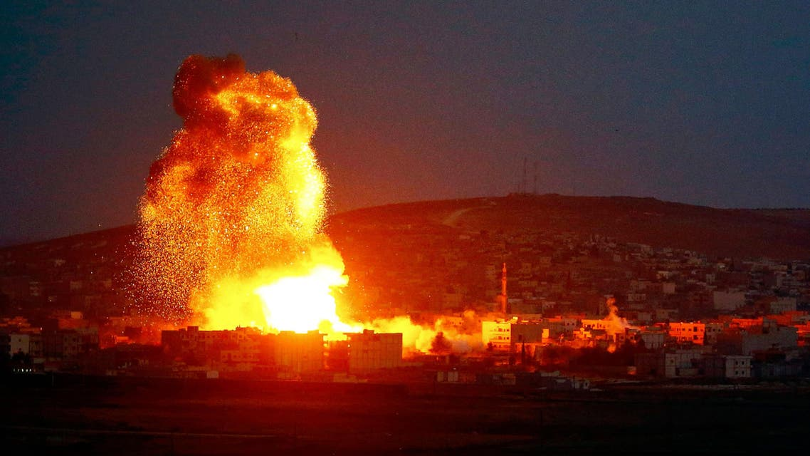 Smoke and flames rise over Syrian town of Kobane after an airstrike, as seen from the Mursitpinar border crossing on the Turkish-Syrian border. (Reuters)