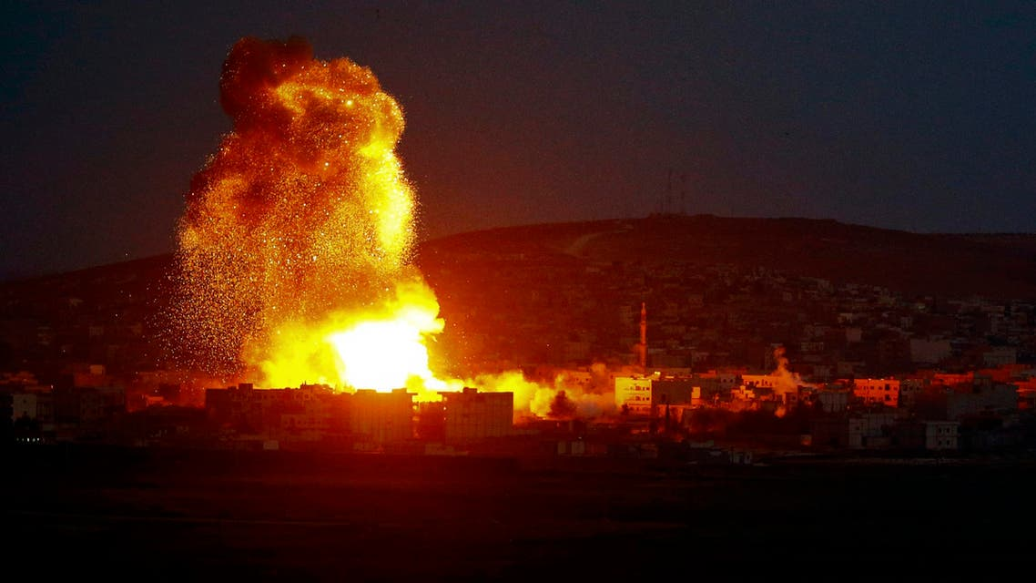 Smoke and flames rise over Syrian town of Kobani after an airstrike, as seen from the Mursitpinar border crossing on the Turkish-Syrian border in the southeastern town of Suruc in Sanliurfa province, October 18, 2014. (Reuters)