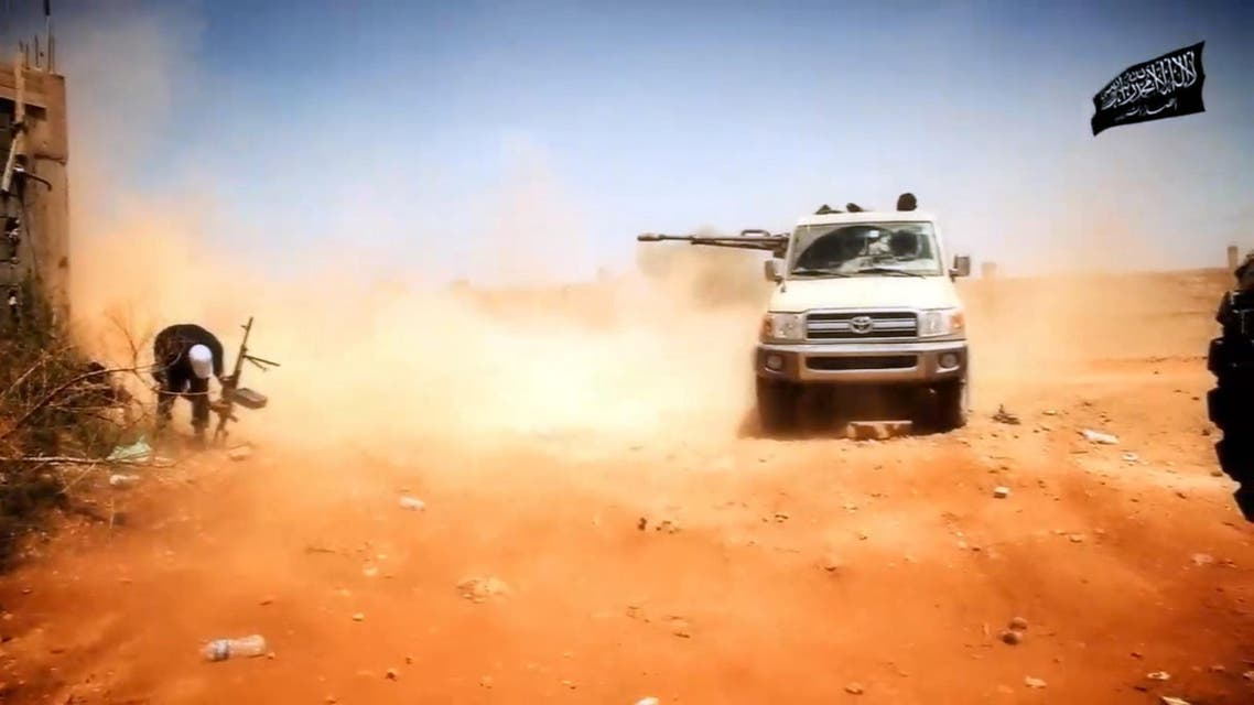 An image taken from a video made available on October 9, 2014, by the official Islamist media outlet of Benghazi-based Islamist Ansar al-Sharia group, al-Raya Media Foundation, allegedly shows Ansar al-Sharia militants during a battle in the Libyan city of Benghazi, AFP