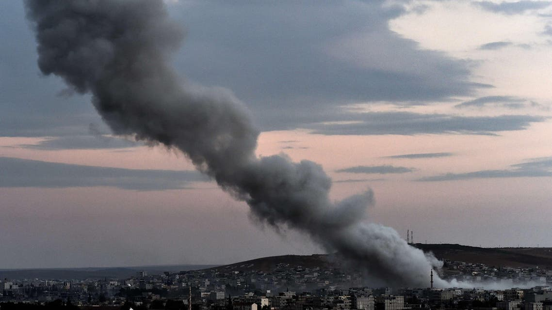 Smoke rises from an explosion in the Syrian town of Kobane, as seen from the Turkish border on October 18, 2014. (AFP)