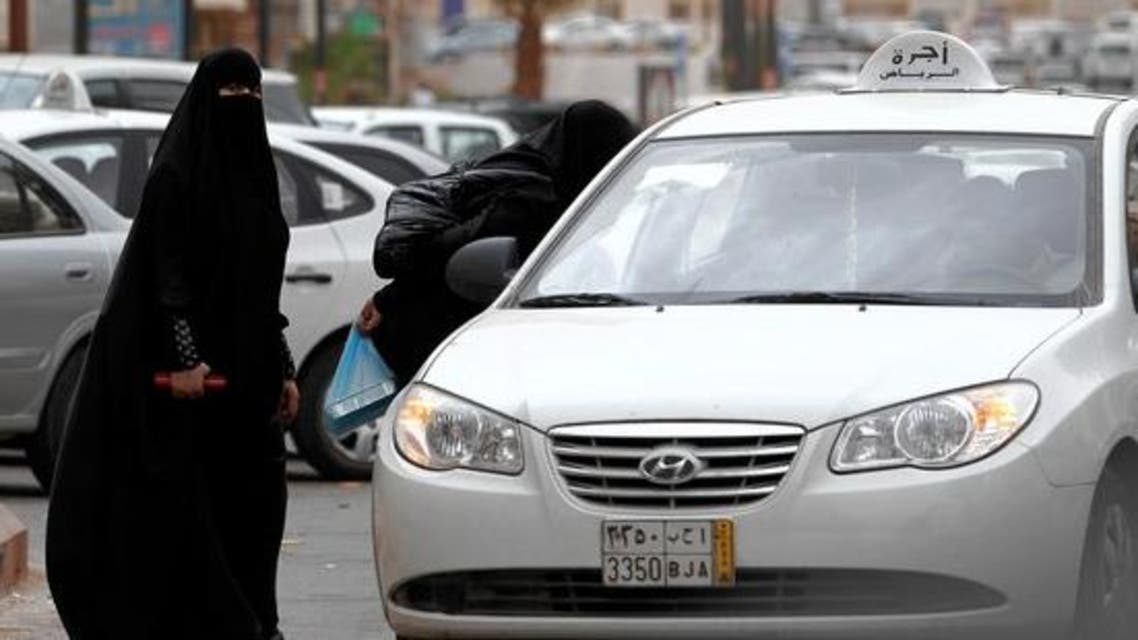 A Saudi woman stands next to a taxi in Riyadh. (Photo courtesy: AP)