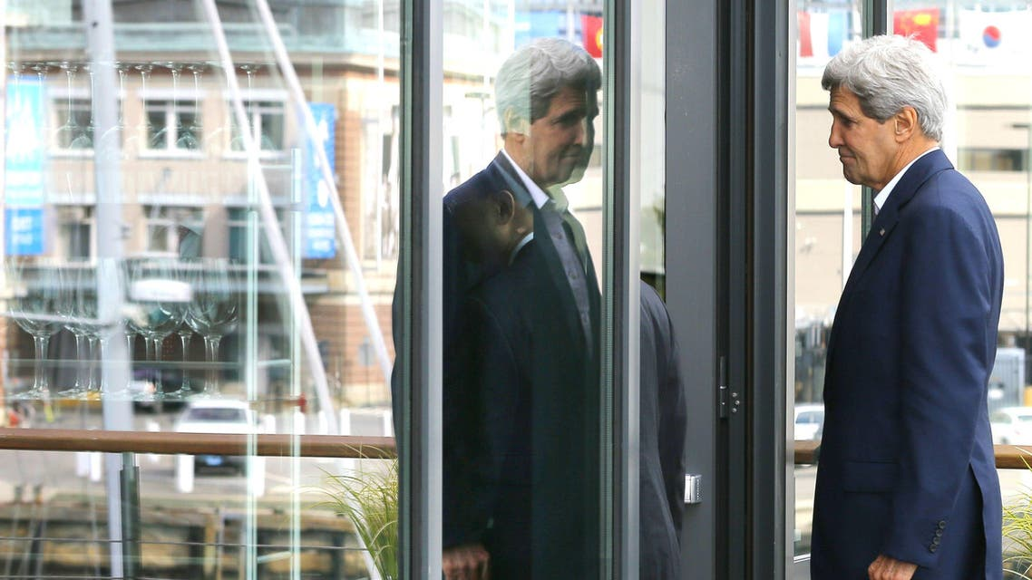 U.S. Secretary of State John Kerry is reflected in a window as he goes to eat lunch with China's State Councillor Yang Jiechi at Legal Harborside restaurant in Boston, Massachusetts October 18, 2014. (Reuters)